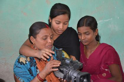 Teaching the women how to use the video camera. Photo:  Photo: Pawan Kumar