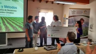 Winners of the Hackathon received their prize from Andy Jarvis and Ana Loboguerrero